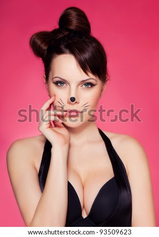 girl with makeup in the incarnation of the cat - stock photo