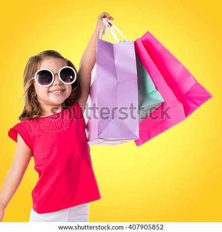 Girl with many shopping bags - stock photo