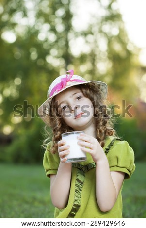 girl with milk glass outdoors picnic