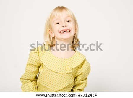 Girl with missing teeth - stock photo