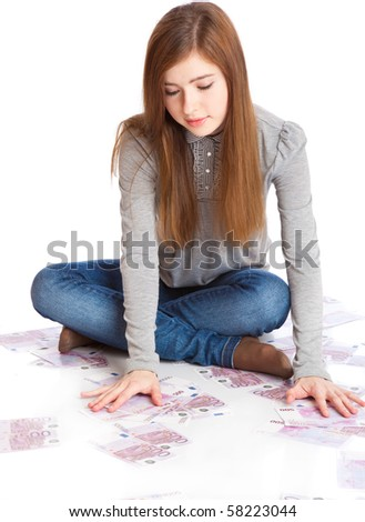Girl with money. Isolated on white background - stock photo