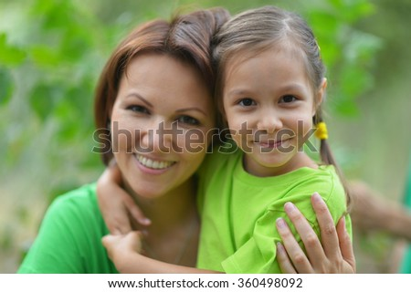 Girl with  mother in summer park