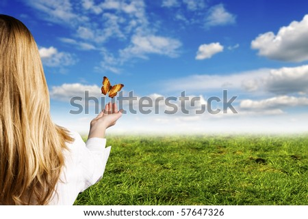 girl with open hand and butterflies flying away - stock photo