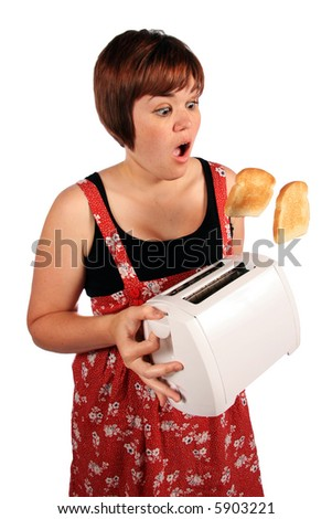 Girl with out of control toaster 2 - stock photo