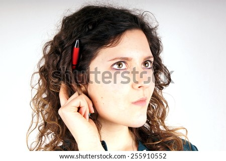 Girl with pen - stock photo