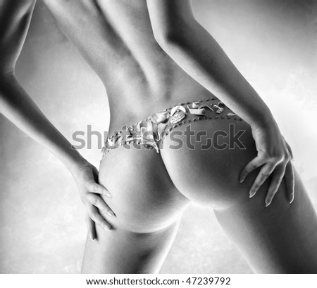 Girl with petals of a flower on buttocks - stock photo