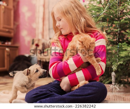 girl with pets on background christmas tree - stock photo