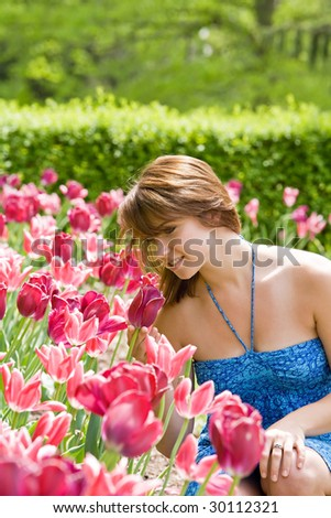 Girl With Pink Tulips - stock photo