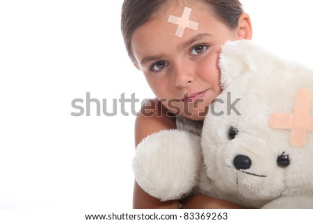 Girl with plaster on head - stock photo