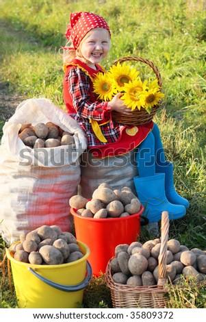girl with potatoes - stock photo