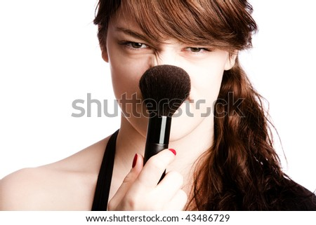 girl with powder brush on her nose studio white