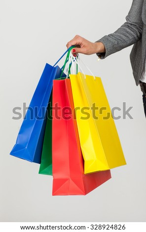 girl with purchases in paper bags color - stock photo