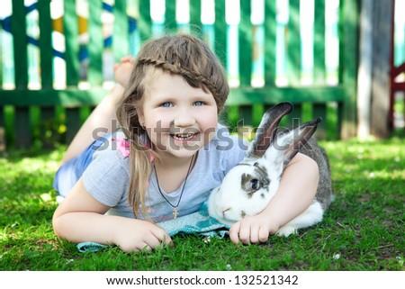 girl with rabbit - stock photo