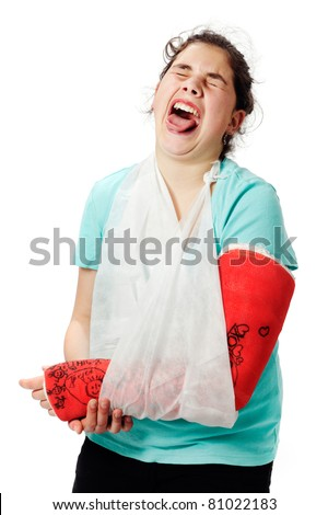 Girl with red cast and sling bandage, has pain and holds her broken arm, studio shot against a white background. - stock photo