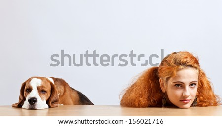 girl with red hair and cute beagle - stock photo