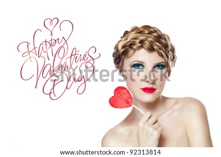 girl with red heart lollipop isolated on white - stock photo