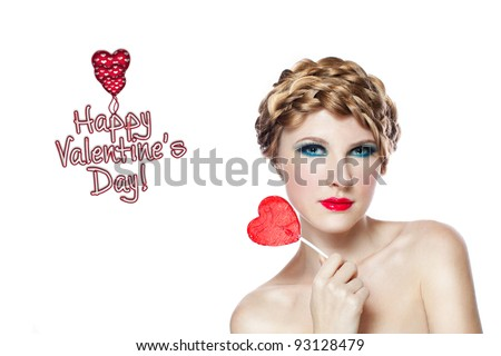 girl with red heart lollipop isolated on white
