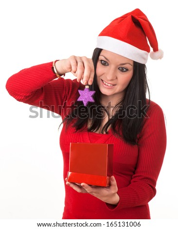 girl with red santa claus hat