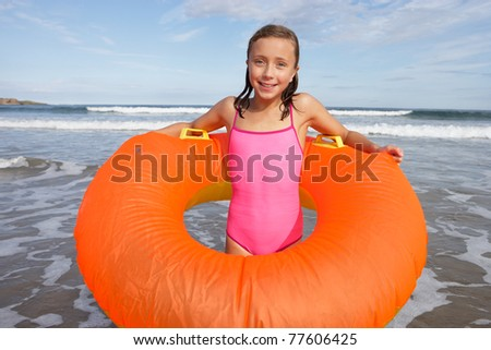 Girl with rubber ring - stock photo