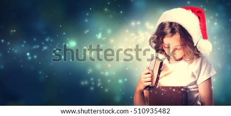 Girl with Santa Hat Opening a Gift Box