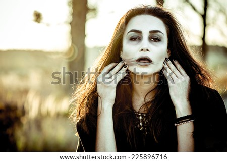 Girl with scary face painting - stock photo