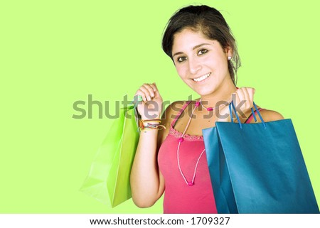 girl with shopping bags over green background