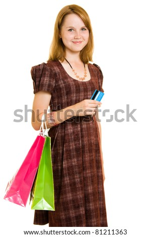 Girl with shopping on white background. - stock photo