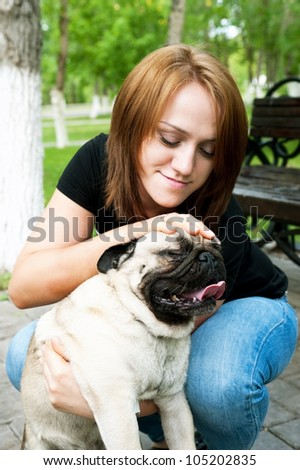 girl with smile on person irons hand its dog