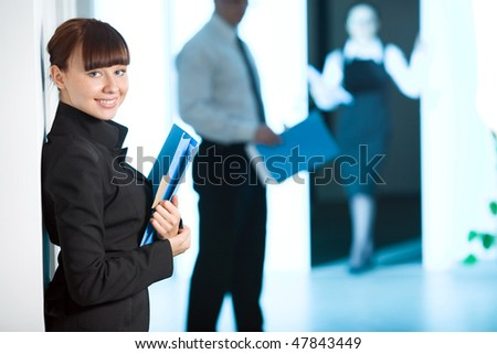 Girl with smile with blue folder - stock photo