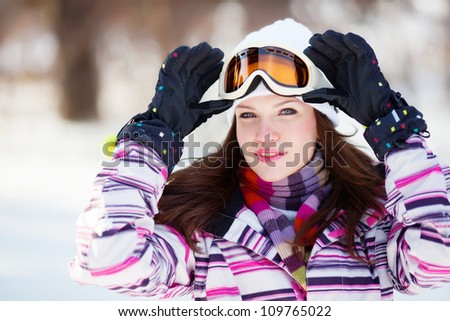Girl with snow mask and gloves - stock photo