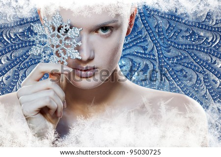 Girl with snowflake, over winter background