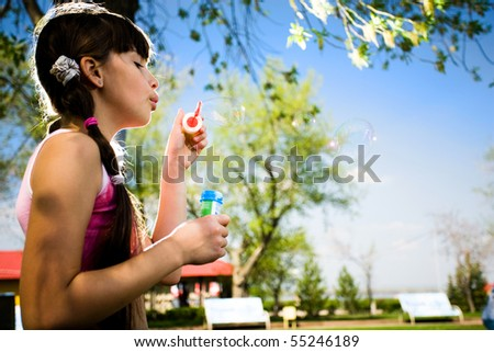 Girl with soap bubbles - stock photo