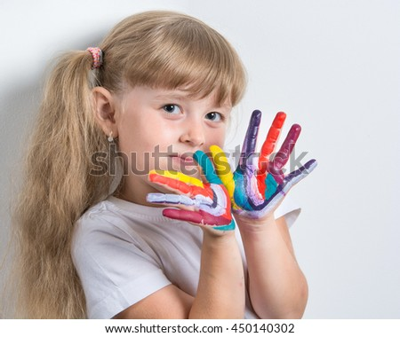 girl with stained in vivid colors palms - stock photo