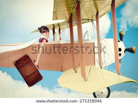 Girl with suitcase flying vintage plane. Photo in old image style. - stock photo
