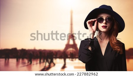 Girl with sunglasses and Parisian background - stock photo