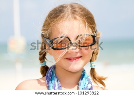 Girl with sunglasses  at the beach - stock photo