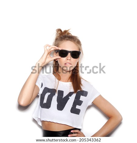 Girl  with sunglasses looking at the camera.  White background, not isolated - stock photo