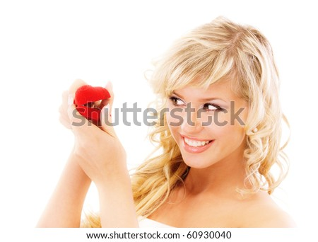 Girl with surprise looks at box with wedding ring, isolated on white background.