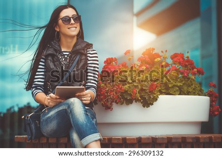 girl with tablet is walking in the downtown - stock photo