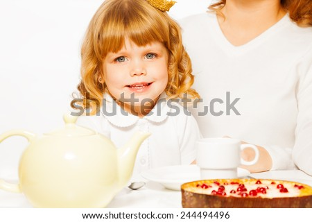 Girl with tea and cake portrait - stock photo