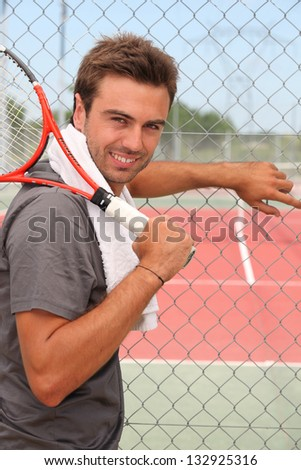 Girl with tennis racket - stock photo