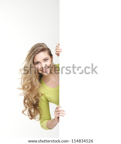 Girl with the blank banner. Perfect space to put any text. - stock photo