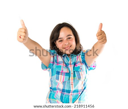 Girl with thumbs up over white background  - stock photo