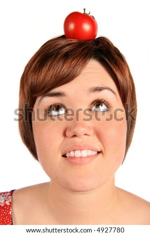 Girl with tomato on head - stock photo