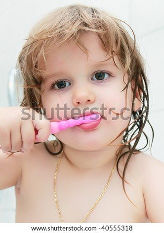Girl with toothbrush - stock photo
