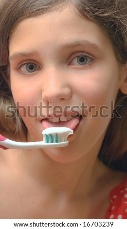 Girl with toothbrush isolated on white