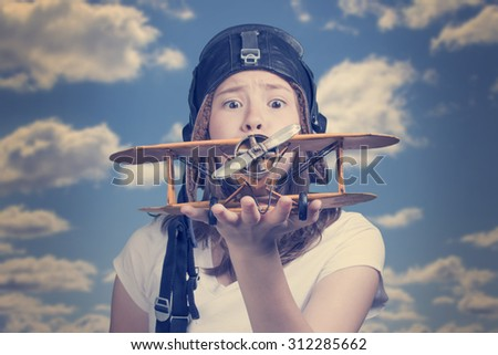 Girl with toy airplane in hand - a symbol of dreams and hopes