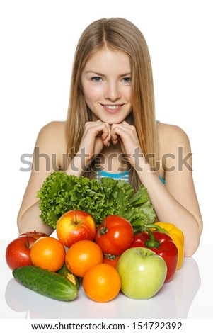 Girl with vegetables isolated on white - stock photo