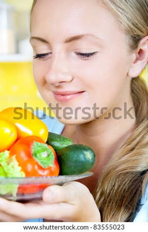 Girl with vegetables on a platter - stock photo