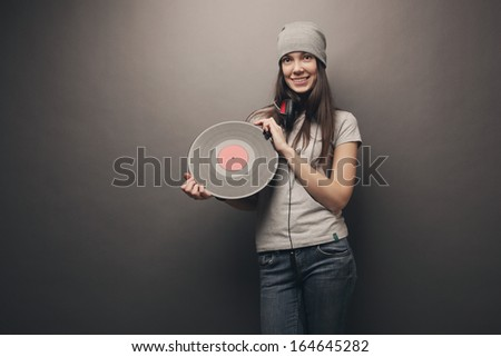 Girl with vinyl records - stock photo